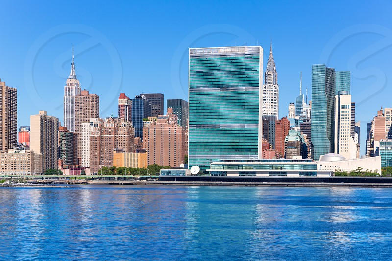 Manhattan New York sunny skyline East River NYC USA photo
