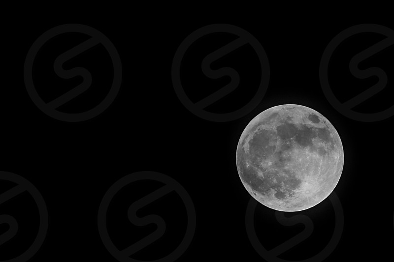 full moon against dark background photo