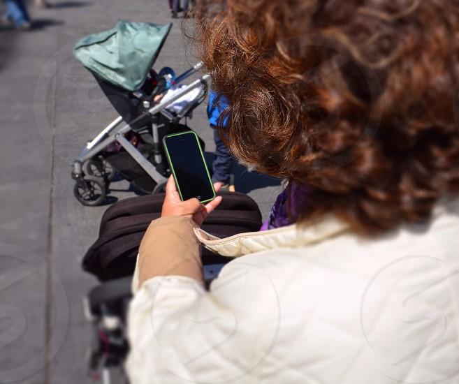 woman using smart phone photo