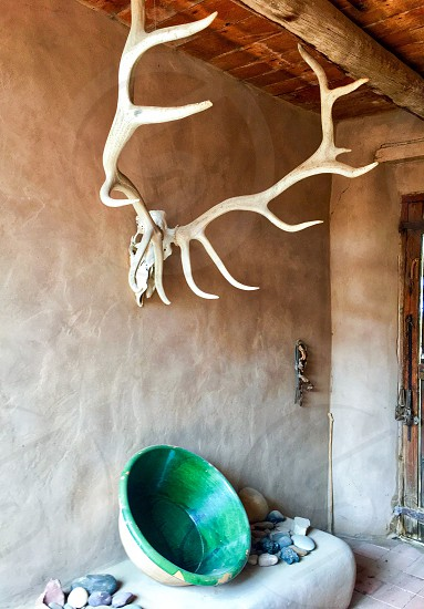 New Mexico Adobe Home and Culture Antlers Adobe Pottery Colorful  photo