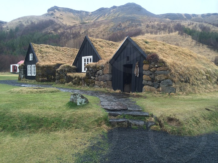 view of black wooden house photo
