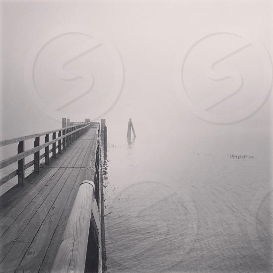 Wood walk on the lake on a foggy morning. Ammersee lake Riederau Germany photo