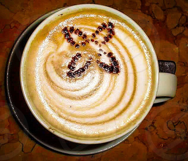 Close up of a Latte with flower design at Cafe Revo Ristorante in West Seattle Washington State USA photo