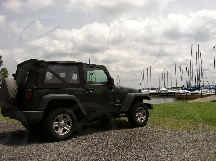 black jeep beside a docking port photo