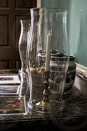 Line of old hurricane  lamps with glass covers photo
