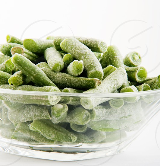green string beans on clear glass bowl photo