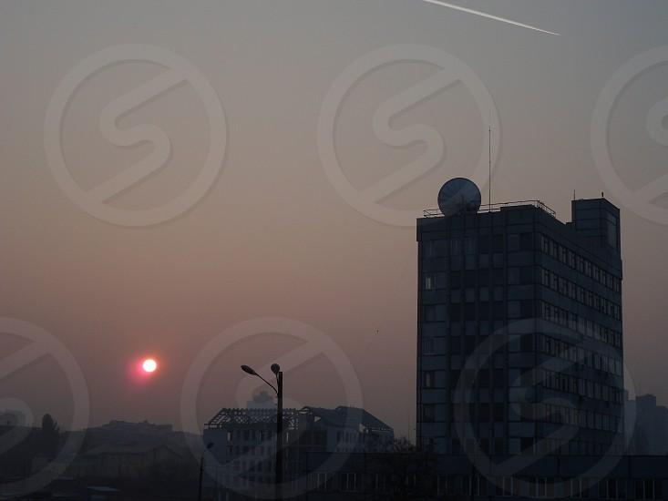 street light near high rise building during sunset photo