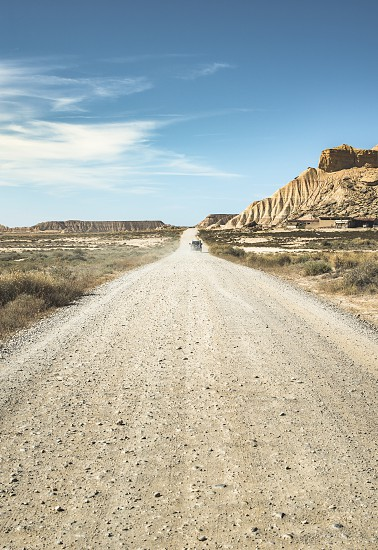 Wild west road and blue sky photo