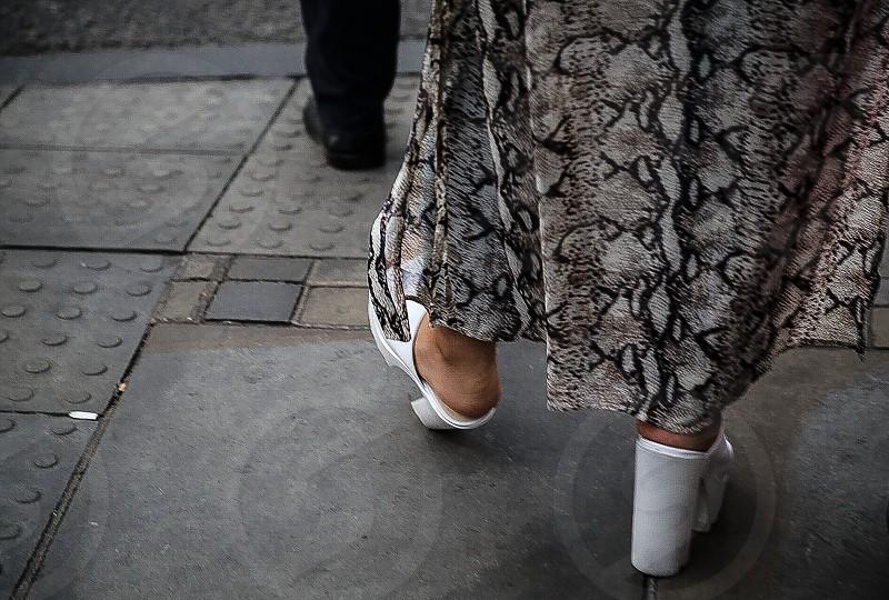 Step steps fashion street street-view  street life  shoes man woman dress cigarette butt butt end asphalt stone sidewalk pavement high heels high heel shoes  sandals relation relations abstract photo