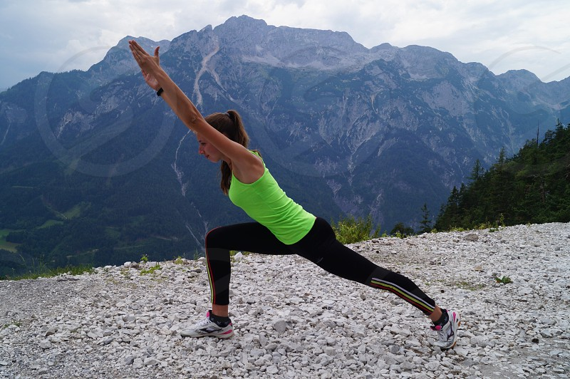 Woman and yoga practice in mountains  photo