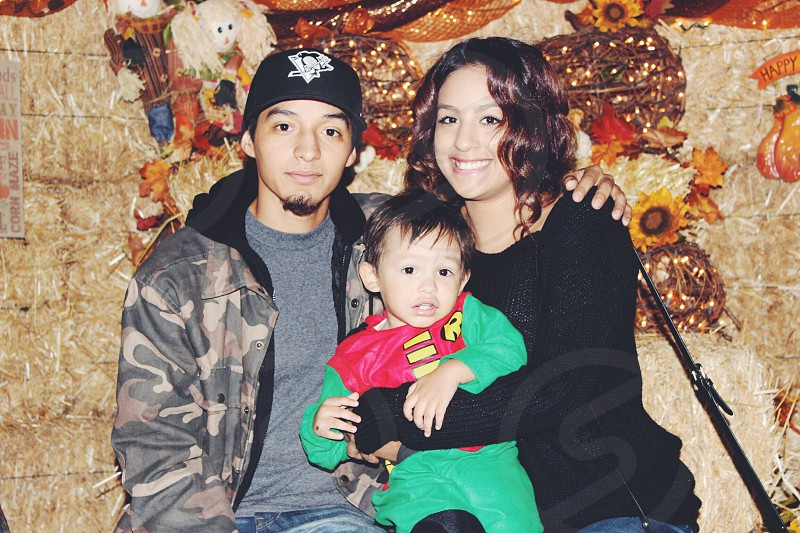 Happy hero family.  photo