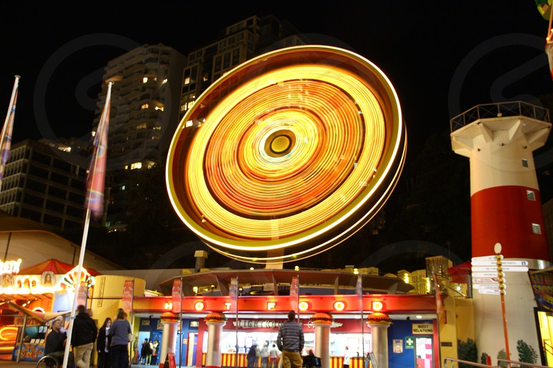 Carnival ride circle long exposure night watching amusement fun photo
