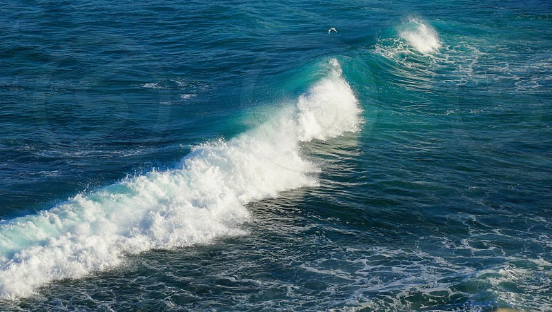 big white Wave and foam motion on beautiful turquoise Blue Ocean idea for summer nature with copy space photo