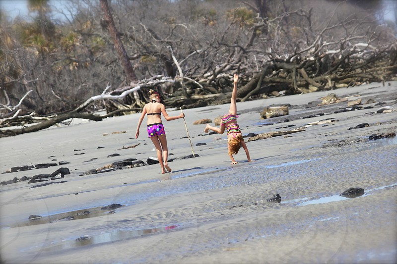 Sisters playing on the beach. photo