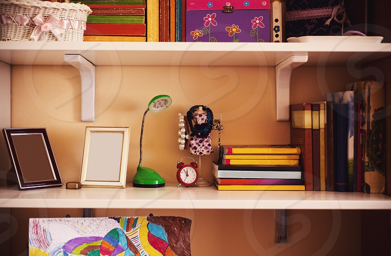 Closeup view on child's shelf with toys books and things that children use.  photo