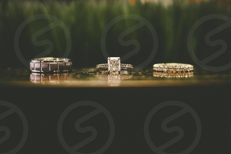 diamond embedded silver rings on table photo