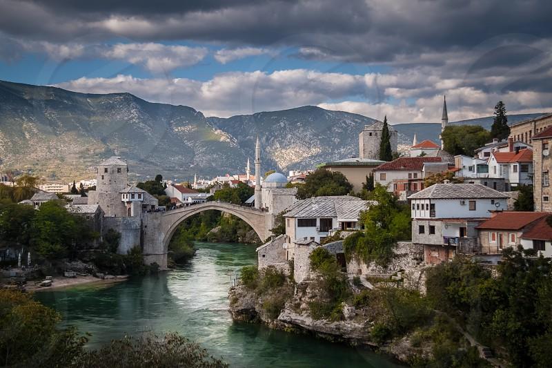 City town Bosnia Mostar river bridge  photo