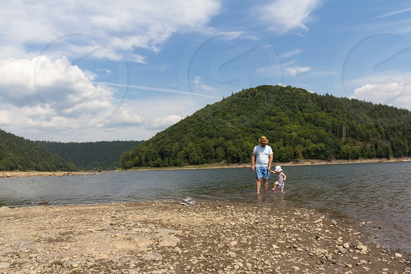 father daughter nature mountain water lake family photo
