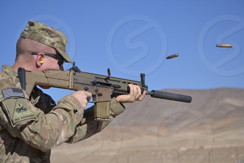 Soldier at range shooting SCAR photo