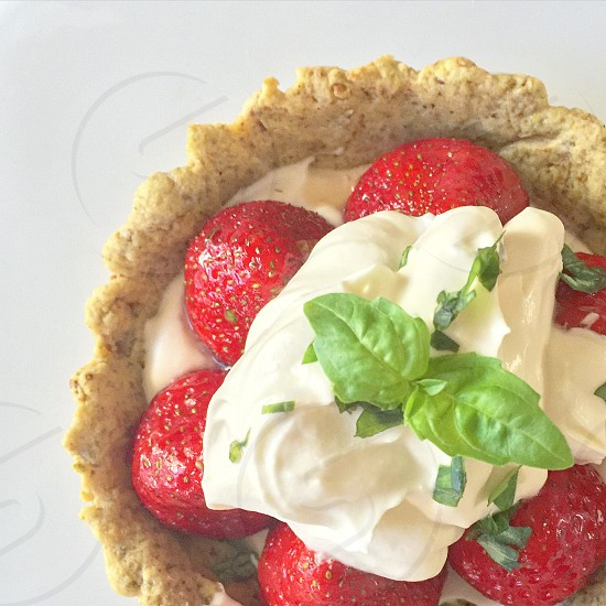 Strawberry Tart with pistachio pastry crust basil-whipped cream and apricot glaze photo