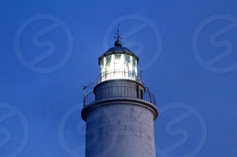Cape barbaria lighthouse sunset lighting in Mediterranean Formentera island photo