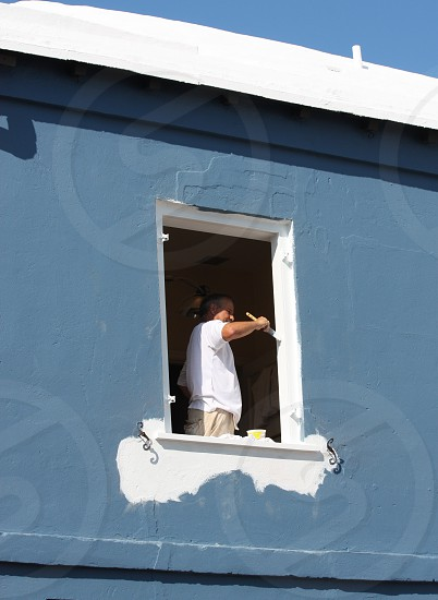 man painting building white photo