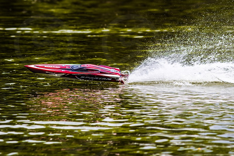 Boat motor boat mini boat mini motor electric gas water lake river green red action splash wet fast remote controlled fly bounce speed boat photo