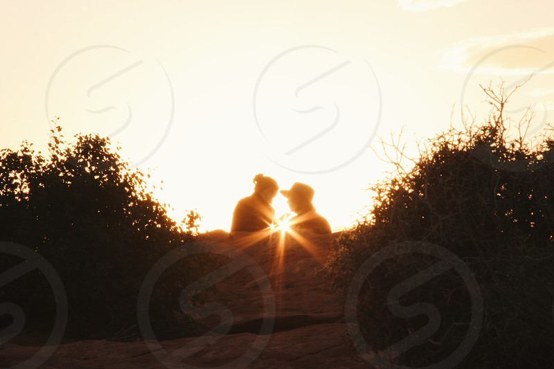 Valentines love couple Young funny vacation passion beautiful laugh smile girlfriend Valentine sunset sunrise Canyon flare  photo