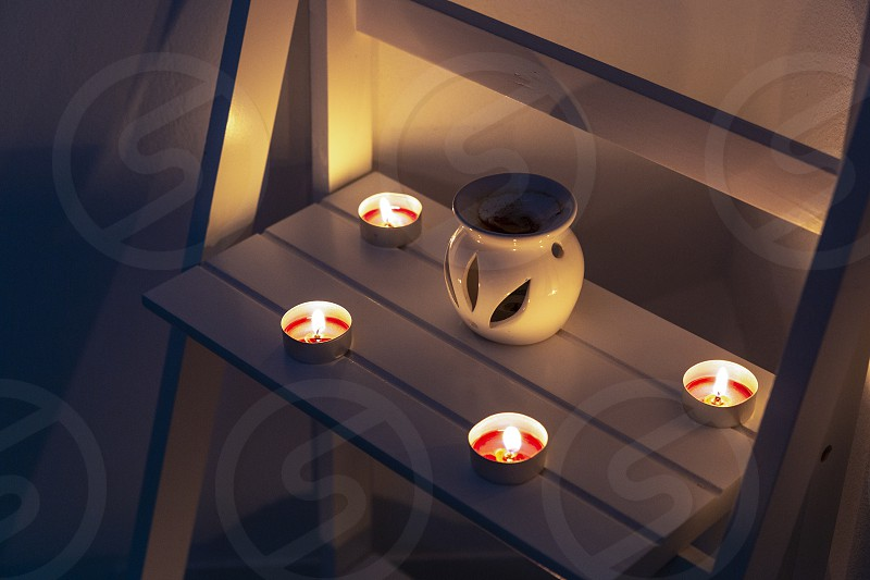 Spa candles and dim lights create a relaxing mood photo