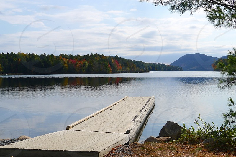 lake view and foot bridge photography photo