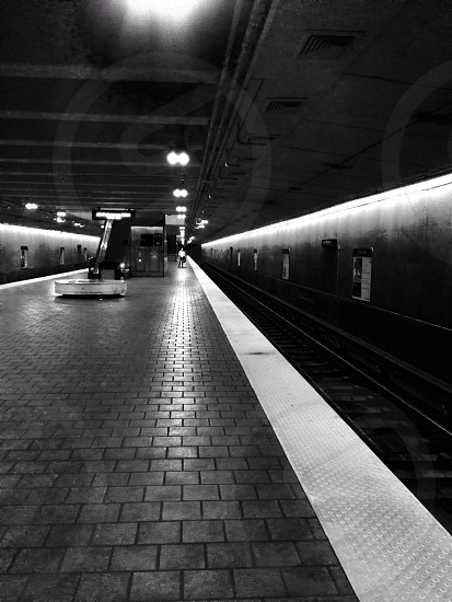 black and white photo of a train station photo