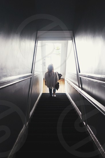 woman in white shirt on stairs photo