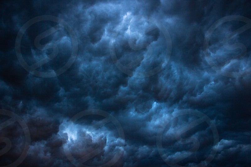 Dark heavy clouds in sky storm thunderstorm photo
