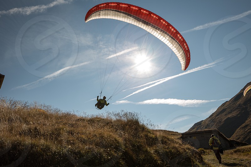 Paraglider paragliding active extreme sport sports outdoors leisure adventure mountains  photo