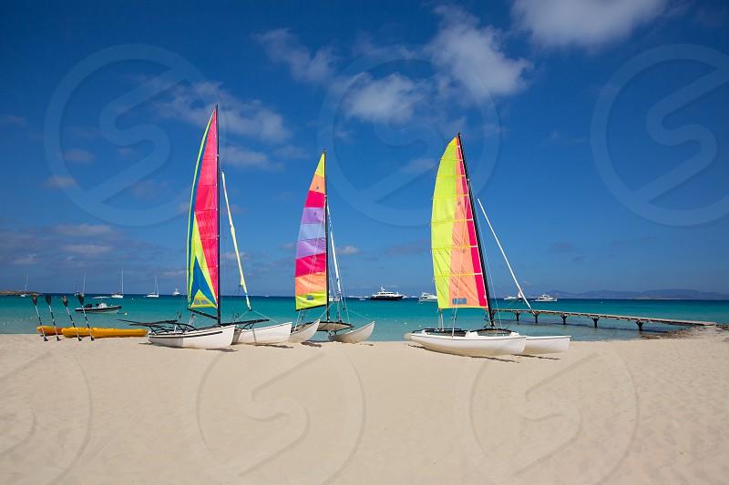 catamaran sailboats in Illetes Formentera beach at Balearic Islands photo