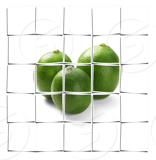 green fresh lime isolated over white background photo