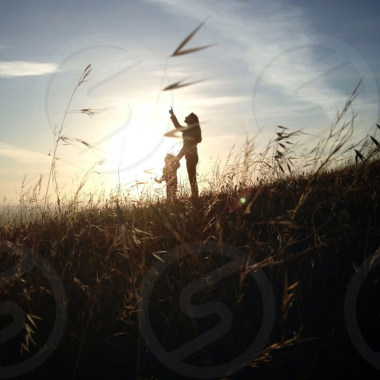 person playing in field with child  photo