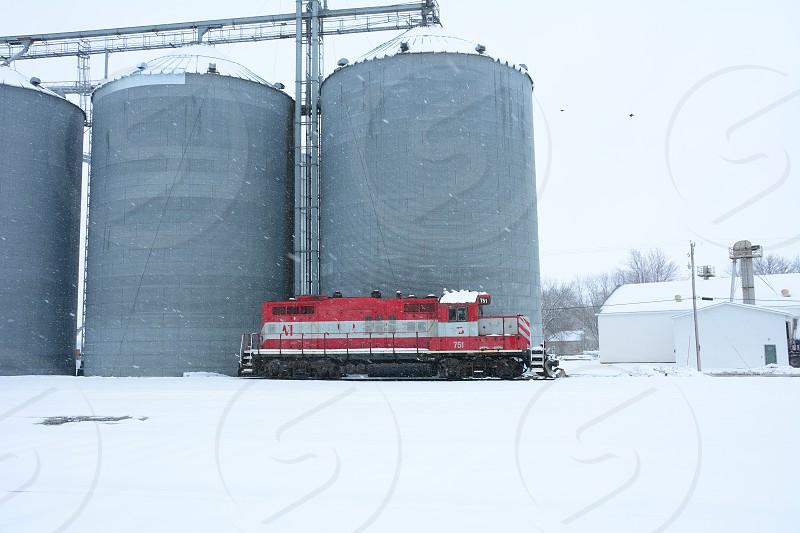 train grain silo winter in Iowa photo