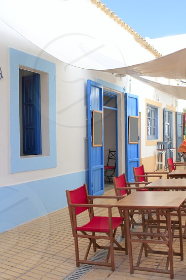 mediterranean street white houses bar Formentera Balearic island photo
