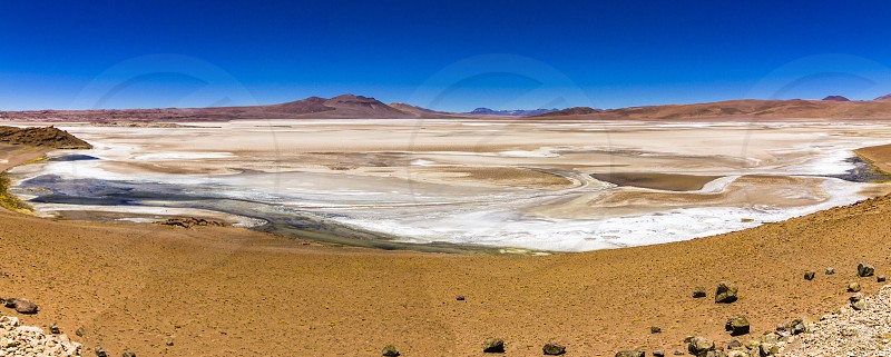 Salt lakes inside Atacama Desert at Chile in the middle of the Andes  photo