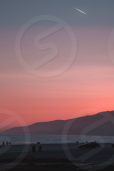 Malibu beach California sunset vacation family mountains  photo