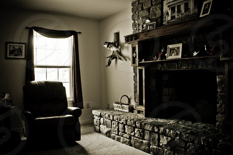 black fireplace and black recliner chair photo