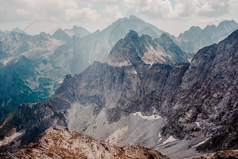 Landscape of jagged peaks in The Tatra Mountains photo