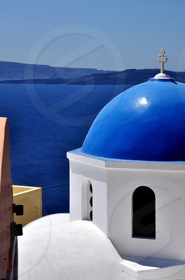 white and blue dome cathedral near sea architecture photography  photo