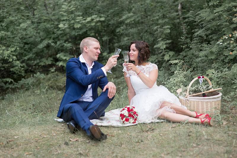 Beautiful wedding couple is enjoying wedding photo