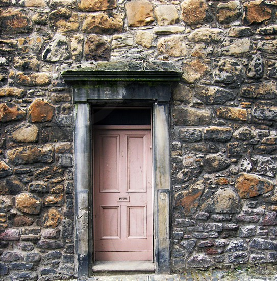 SCOTLAND. Edinburgh a small doorway in a stone wall in the Old Town area of Edinburgh. photo