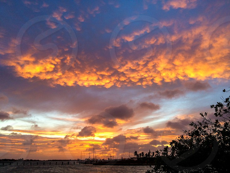 Fire sky sunset aruba sea ocean water lagoon  photo