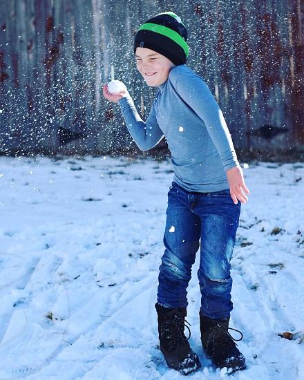 Snowball fight candid fun  little boy photo