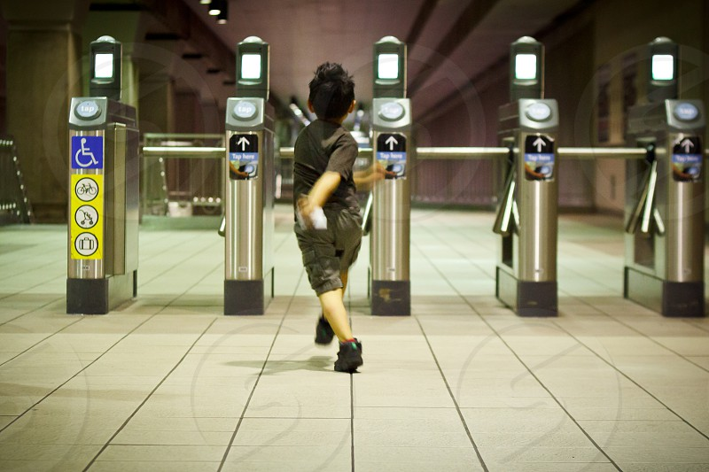 Little boy skipping in the subway. photo