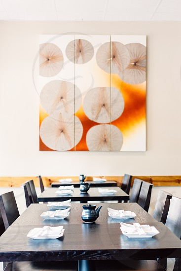 white orange and beige fan like paintings on white wall photo